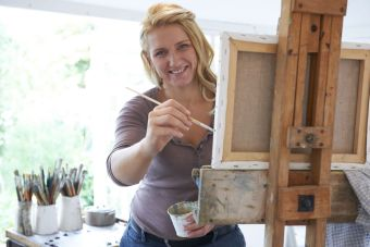 Portrait Of Female Artist Painting In Studio